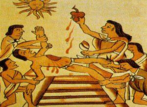los nativos riegan la cancha con la sangre de los sacrificados tras el término del partido.